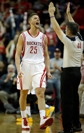 Apr 6, 2014; Houston, TX, USA; Houston Rockets forward Chandler Parsons (25) yells after making a three-pointer during overtime against the Denver Nuggets at Toyota Center. The Houston Rockets beat the Denver Nuggets 130-125. Mandatory Credit: Andrew Richardson-USA TODAY Sports
