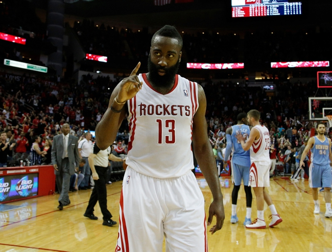 Apr 6, 2014; Houston, TX, USA; Houston Rockets guard James Harden (13) holds up one finger following the Houston Rockets 130-125 overtime win against the Denver Nuggets at Toyota Center. Mandatory Credit: Andrew Richardson-USA TODAY Sports