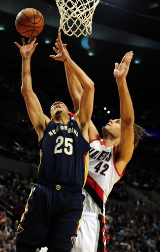 Apr 6, 2014; Portland, OR, USA; New Orleans Pelicans guard Austin Rivers (25) shoots against Portland Trail Blazers center Robin Lopez (42) during the first quarter at Moda Center. Mandatory Credit: Steve Dykes-USA TODAY Sports