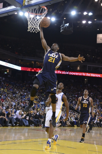 Apr 6, 2014; Oakland, CA, USA; Utah Jazz guard Ian Clark (21) dunks the ball against the Golden State Warriors during the fourth quarter at Oracle Arena. The Warriors defeated the Jazz 130-102. Mandatory Credit: Kyle Terada-USA TODAY Sports