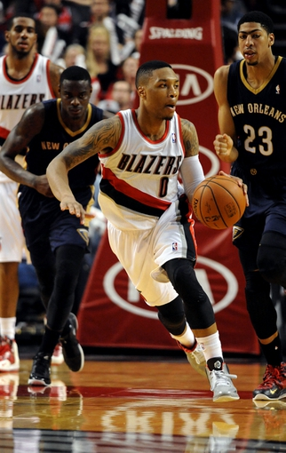 Apr 6, 2014; Portland, OR, USA; Portland Trail Blazers guard Damian Lillard (0) brings the ball up the court during the fourth quarter of the game against the New Orleans Pelicans at the Moda Center. The Blazers won the game 100-94. Mandatory Credit: Steve Dykes-USA TODAY Sports
