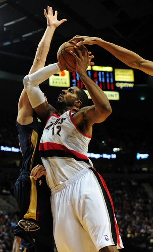 Apr 6, 2014; Portland, OR, USA; Portland Trail Blazers forward LaMarcus Aldridge (12) has his shot blocked as he drives to the basket on New Orleans Pelicans center Greg Stiemsma (34) during the third quarter of the game at the Moda Center. The Blazers won the game 100-94. Mandatory Credit: Steve Dykes-USA TODAY Sports