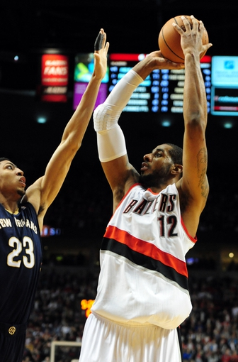 Apr 6, 2014; Portland, OR, USA; Portland Trail Blazers forward LaMarcus Aldridge (12) shoots the ball over New Orleans Pelicans forward Anthony Davis (23) during the third quarter of the game at the Moda Center. The Blazers won the game 100-94. Mandatory Credit: Steve Dykes-USA TODAY Sports