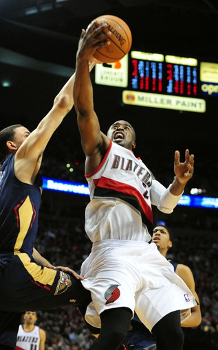 Apr 6, 2014; Portland, OR, USA; Portland Trail Blazers guard Wesley Matthews (2) drives to the basket on New Orleans Pelicans guard Austin Rivers (25) during the fourth quarter of the game at the Moda Center. The Blaz