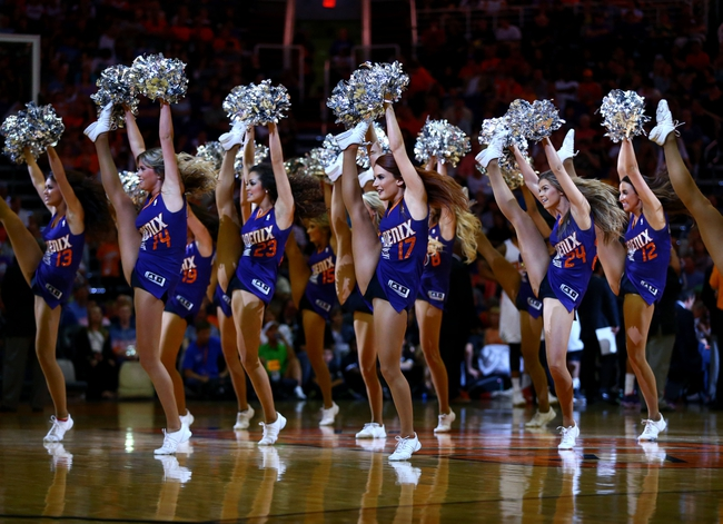 Apr 6, 2014; Phoenix, AZ, USA; Phoenix Suns dancers perform against the Oklahoma City Thunder at US Airways Center. The Suns defeated the Thunder 122-115. Mandatory Credit: Mark J. Rebilas-USA TODAY Sports