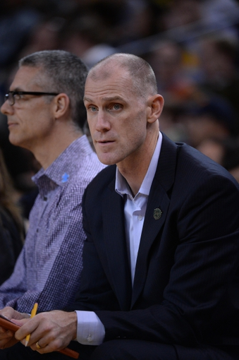 April 4, 2014; Oakland, CA, USA; Sacramento Kings assistant coach Chris Jent looks on during the third quarter against the Golden State Warriors at Oracle Arena. The Warriors defeated the Kings 102-69. Mandatory Credit: Kyle Terada-USA TODAY Sports