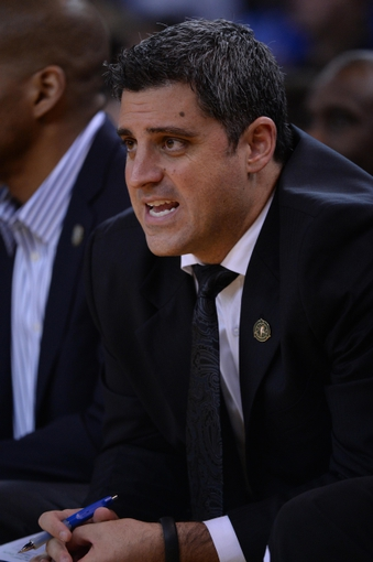 April 4, 2014; Oakland, CA, USA; Sacramento Kings assistant coach Micah Nori looks on during the third quarter against the Golden State Warriors at Oracle Arena. The Warriors defeated the Kings 102-69. Mandatory Credit: Kyle Terada-USA TODAY Sports