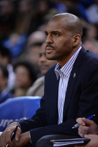 April 4, 2014; Oakland, CA, USA; Sacramento Kings assistant coach Corliss Williamson looks on during the third quarter against the Golden State Warriors at Oracle Arena. The Warriors defeated the Kings 102-69. Mandatory Credit: Kyle Terada-USA TODAY Sports