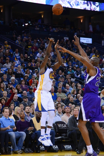 April 4, 2014; Oakland, CA, USA; Golden State Warriors forward Draymond Green (23) shoots the ball against the Sacramento Kings during the fourth quarter at Oracle Arena. The Warriors defeated the Kings 102-69. Mandatory Credit: Kyle Terada-USA TODAY Sports
