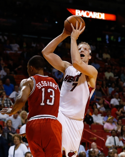 Apr 2, 2014; Miami, FL, USA; Miami Heat center Justin Hamilton (7) shoots the ball over Milwaukee Bucks guard Ramon Sessions (13)    in the second half at American Airlines Arena. The Heat won 96-77.  Mandatory Credit: Robert Mayer-USA TODAY Sports