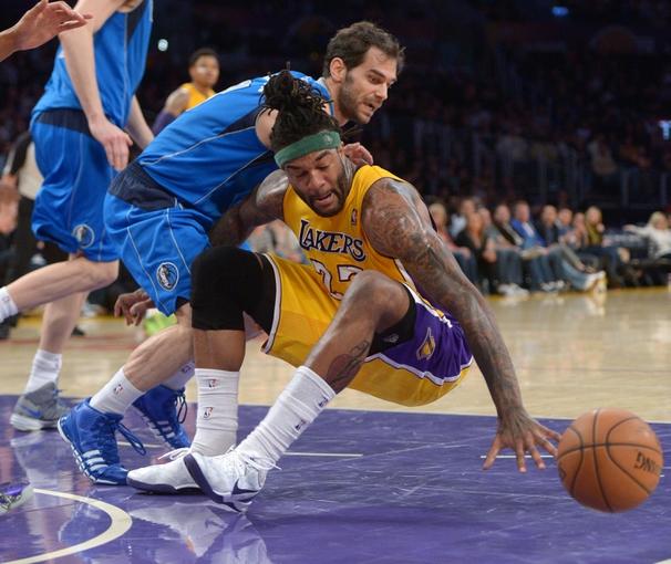 Apr 4, 2014; Los Angeles, CA, USA; Los Angeles Lakers forward Jordan Hill (27) and Dallas Mavericks guard Jose Calderon (8) scramble for the ball at Staples Center. The Mavericks defeated the Lakers 107-95.  Mandatory Credit: Kirby Lee-USA TODAY Sports