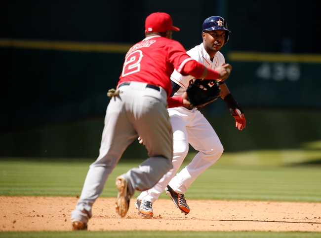 Apr 7, 2014; Houston, TX, USA; Los Angeles Angels shortstop Erick Aybar (2) tags out Houston Astros right fielder L.J. Hoes (28) during the eighth inning at Minute Maid Park. Mandatory Credit: Andrew Richardson-USA TODAY Sports