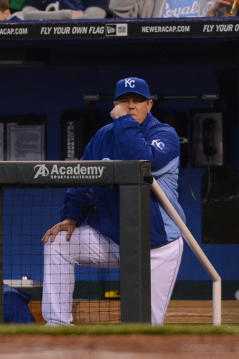 Apr 7, 2014; Kansas City, MO, USA; Kansas City Royals manager Ned Yost (3) watches play from the dugout in the second inning against the Tampa Bay Rays at Kauffman Stadium. Mandatory Credit: Denny Medley-USA TODAY Sports