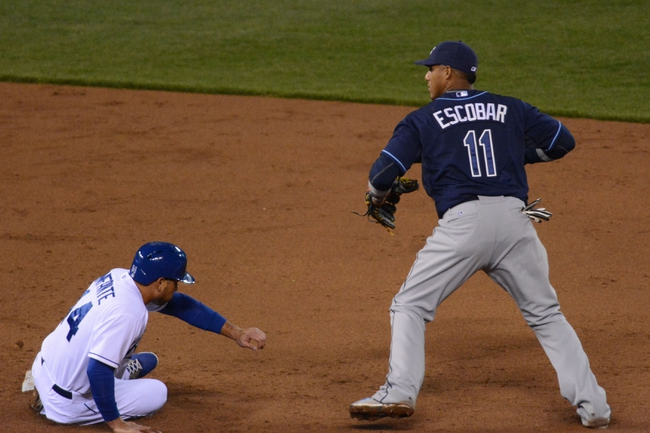 Apr 7, 2014; Kansas City, MO, USA; Tampa Bay Rays shortstop Yunel Escobar (11) makes the out on Kansas City Royals second baseman Omar Infante (14) at second base in the third inning at Kauffman Stadium. Mandatory Credit: Denny Medley-USA TODAY Sports