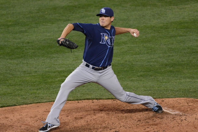 Apr 7, 2014; Kansas City, MO, USA; Tampa Bay Rays starting pitcher Matt Moore (55) delivers a pitch in the third inning against the Kansas City Royals at Kauffman Stadium. Mandatory Credit: Denny Medley-USA TODAY Sports