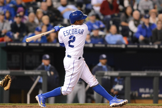 Apr 7, 2014; Kansas City, MO, USA; Kansas City Royals shortstop Alcides Escobar (2) connects for a three run double in the sixth inning against the Tampa Bay Rays at Kauffman Stadium. Mandatory Credit: Denny Medley-USA TODAY Sports