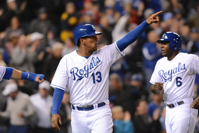 Apr 7, 2014; Kansas City, MO, USA; Kansas City Royals catcher Salvador Perez (13) celebrates after scoring in the sixth inning against the Tampa Bay Rays at Kauffman Stadium. Mandatory Credit: Denny Medley-USA TODAY Sports