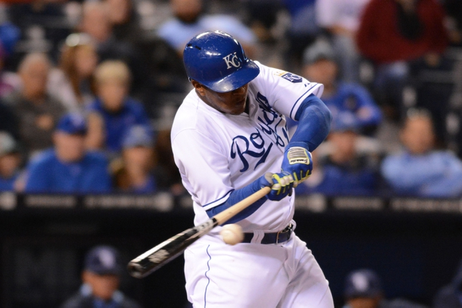 Apr 7, 2014; Kansas City, MO, USA; Kansas City Royals catcher Salvador Perez (13) connects for a single in the sixth inning against the Tampa Bay Rays at Kauffman Stadium. Mandatory Credit: Denny Medley-USA TODAY Sports