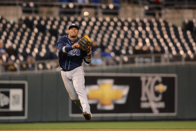 Apr 7, 2014; Kansas City, MO, USA; Tampa Bay Rays shortstop Yunel Escobar (11) fields a ball and throws to first base in the sixth inning against the Kansas City Royals at Kauffman Stadium. Mandatory Credit: Denny Medley-USA TODAY Sports