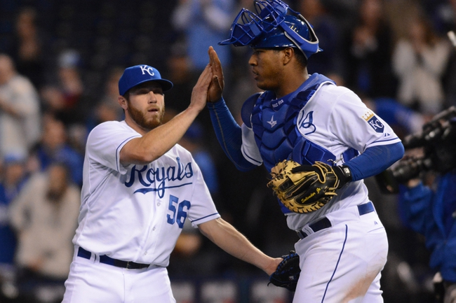 Apr 7, 2014; Kansas City, MO, USA; Kansas City Royals relief pitcher Greg Holland (56) is congratulated by catcher Salvador Perez (13) after the game against the Tampa Bay Rays at Kauffman Stadium. The Royals won 4-2.  Mandatory Credit: Denny Medley-USA TODAY Sports