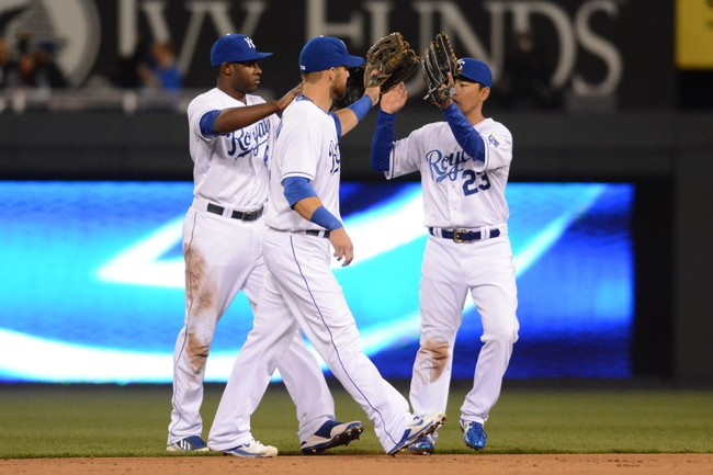 Apr 7, 2014; Kansas City, MO, USA; Kansas City Royals center fielder Lorenzo Cain (6), left fielder Alex Gordon (4) and right fielder Norichika Aoki (23) celebrate in the outfield after the game against the Tampa Bay Rays at Kauffman Stadium. The Royals won 4-2.  Mandatory Credit: Denny Medley-USA TODAY Sports