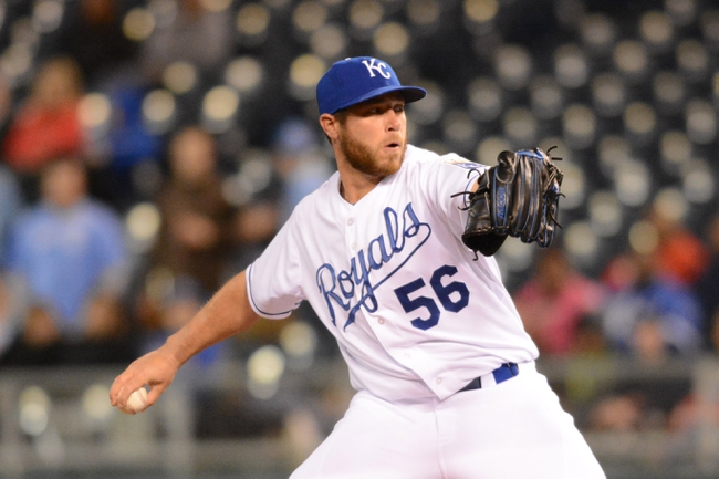 Apr 7, 2014; Kansas City, MO, USA; Kansas City Royals relief pitcher Greg Holland (56) delivers a pitch in the ninth inning against the Tampa Bay Rays at Kauffman Stadium. The Royals won 4-2.  Mandatory Credit: Denny Medley-USA TODAY Sports