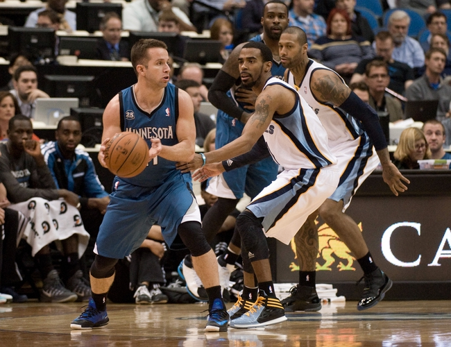 Apr 2, 2014; Minneapolis, MN, USA;  Minnesota Timberwolves guard Jose Barea (11) guarded by Memphis Grizzlies guard Mike Conley (11) in the first half at Target Center. The Wolves defeated the Grizzlies 102-88.  Mandatory Credit: Marilyn Indahl-USA TODAY Sports