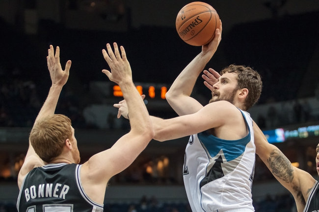 Apr 8, 2014; Minneapolis, MN, USA; Minnesota Timberwolves forward Kevin Love (42) shoots against San Antonio Spurs forward Matt Bonner (15) at Target Center. Mandatory Credit: Brad Rempel-USA TODAY Sports