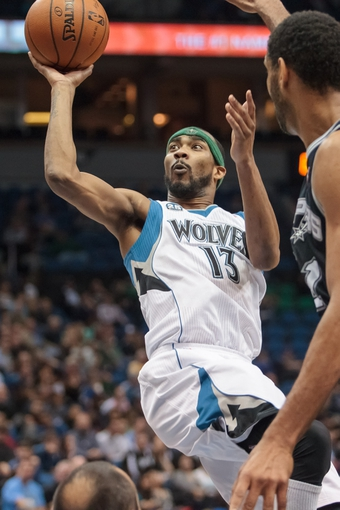 Apr 8, 2014; Minneapolis, MN, USA; Minnesota Timberwolves forward Corey Brewer (13) shoots in the second quarter against the San Antonio Spurs at Target Center. Mandatory Credit: Brad Rempel-USA TODAY Sports