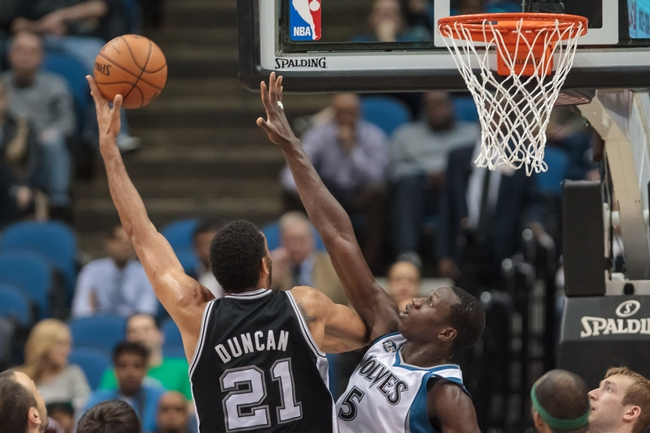 Apr 8, 2014; Minneapolis, MN, USA; San Antonio Spurs forward Tim Duncan (21) shoots in the second quarter against the Minnesota Timberwolves center Gorgui Dieng (5) at Target Center. Mandatory Credit: Brad Rempel-USA TODAY Sports