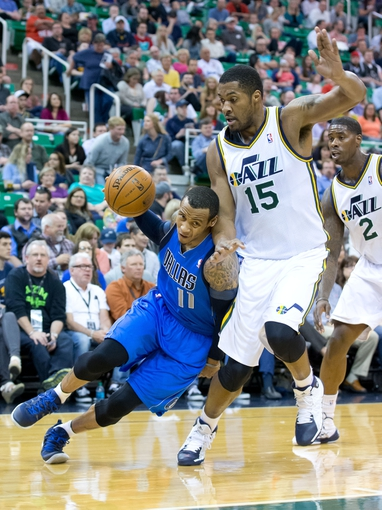 Apr 8, 2014; Salt Lake City, UT, USA; Dallas Mavericks guard Monta Ellis (11) attempts to dribble around Utah Jazz center Derrick Favors (15) during the first quarter at EnergySolutions Arena. Mandatory Credit: Russ Isabella-USA TODAY Sports