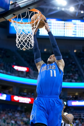 Apr 8, 2014; Salt Lake City, UT, USA; Dallas Mavericks guard Monta Ellis (11) dunks during the first half against the Utah Jazz at EnergySolutions Arena. Mandatory Credit: Russ Isabella-USA TODAY Sports