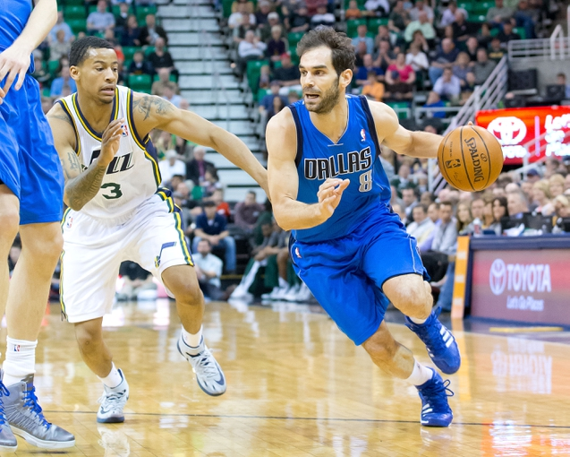 Apr 8, 2014; Salt Lake City, UT, USA; Dallas Mavericks guard Jose Calderon (8) dribbles up court while pursued by Utah Jazz guard Trey Burke (3) during the first half at EnergySolutions Arena. Mandatory Credit: Russ Isabella-USA TODAY Sports