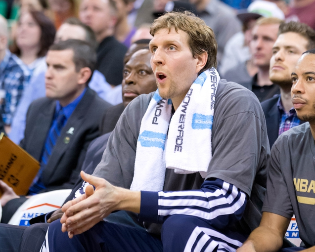 Apr 8, 2014; Salt Lake City, UT, USA; Dallas Mavericks forward Dirk Nowitzki (41) watches from the bench during the first half against the Utah Jazz at EnergySolutions Arena. Mandatory Credit: Russ Isabella-USA TODAY Sports