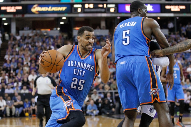 Apr 8, 2014; Sacramento, CA, USA; Oklahoma City Thunder guard Thabo Sefolosha (25) dribbles the ball against the Sacramento Kings in the first quarter at Sleep Train Arena. Mandatory Credit: Cary Edmondson-USA TODAY Sports