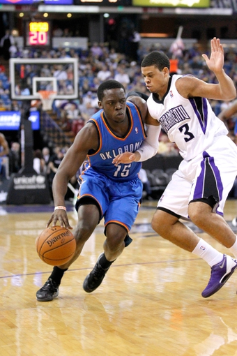 Apr 8, 2014; Sacramento, CA, USA; Oklahoma City Thunder guard Reggie Jackson (15) dribbles past Sacramento Kings guard Ray McCallum (3) in the first quarter at Sleep Train Arena. Mandatory Credit: Cary Edmondson-USA TODAY Sports