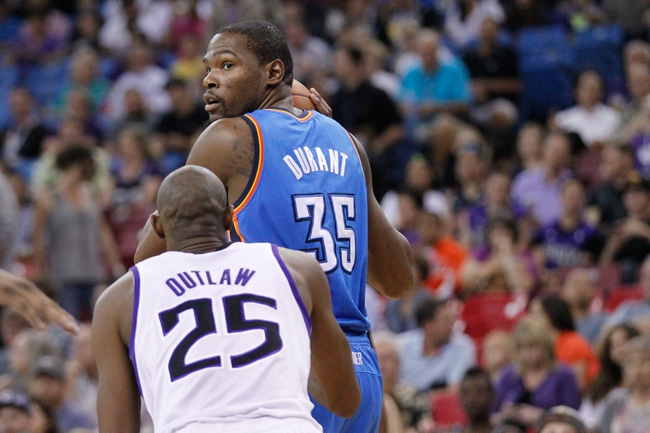 Apr 8, 2014; Sacramento, CA, USA; Oklahoma City Thunder forward Kevin Durant (35) looks to pass the ball against the Sacramento Kings in the first quarter at Sleep Train Arena. Mandatory Credit: Cary Edmondson-USA TODAY Sports