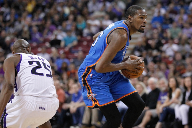 Apr 8, 2014; Sacramento, CA, USA; Oklahoma City Thunder forward Kevin Durant (35) drives past Sacramento Kings forward Travis Outlaw (25) in the first quarter at Sleep Train Arena. Mandatory Credit: Cary Edmondson-USA TODAY Sports