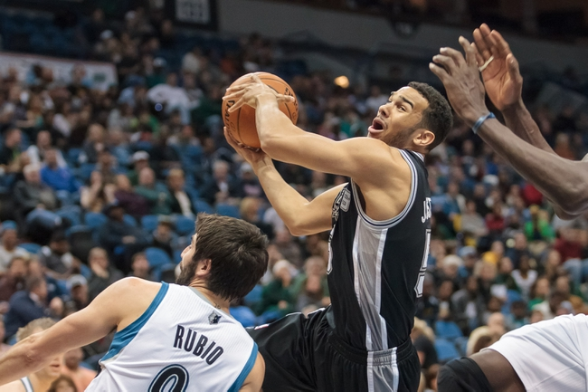 Apr 8, 2014; Minneapolis, MN, USA; San Antonio Spurs guard Cory Joseph (5) shoots in the third quarter against the Minnesota Timberwolves at Target Center. The Minnesota Timberwolves win 110-91. Mandatory Credit: Brad Rempel-USA TODAY Sports