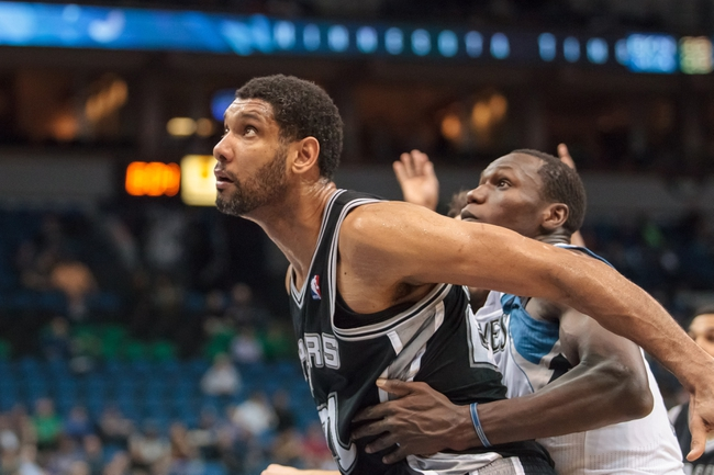 Apr 8, 2014; Minneapolis, MN, USA; San Antonio Spurs forward Tim Duncan (21) boxes out Minnesota Timberwolves center Gorgui Dieng (5) in the second quarter at Target Center. The Minnesota Timberwolves win 110-91. Mandatory Credit: Brad Rempel-USA TODAY Sports