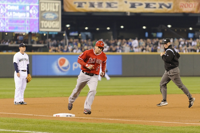 Apr 8, 2014; Seattle, WA, USA; Los Angeles Angels third baseman David Freese (6) rounds third base after hitting a solo home run against the Seattle Mariners during the first inning at Safeco Field. Mandatory Credit: Steven Bisig-USA TODAY Sports