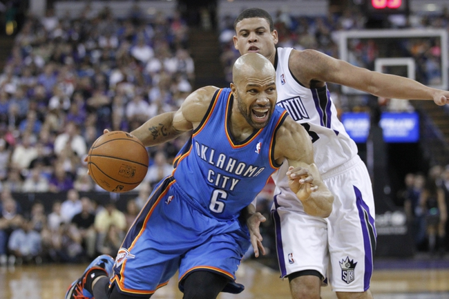Apr 8, 2014; Sacramento, CA, USA; Oklahoma City Thunder guard Derek Fisher (6) drives past Sacramento Kings guard Ray McCallum (3) in the second quarter at Sleep Train Arena. Mandatory Credit: Cary Edmondson-USA TODAY Sports