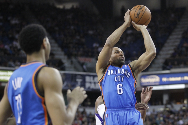 Apr 8, 2014; Sacramento, CA, USA; Oklahoma City Thunder guard Derek Fisher (6) attempts a shot against the Sacramento Kings in the second quarter at Sleep Train Arena. Mandatory Credit: Cary Edmondson-USA TODAY Sports
