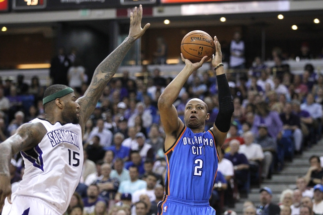 Apr 8, 2014; Sacramento, CA, USA; Oklahoma City Thunder forward Caron Butler (2) attempts a shot over Sacramento Kings center DeMarcus Cousins (15) in the second quarter at Sleep Train Arena. Mandatory Credit: Cary Edmondson-USA TODAY Sports