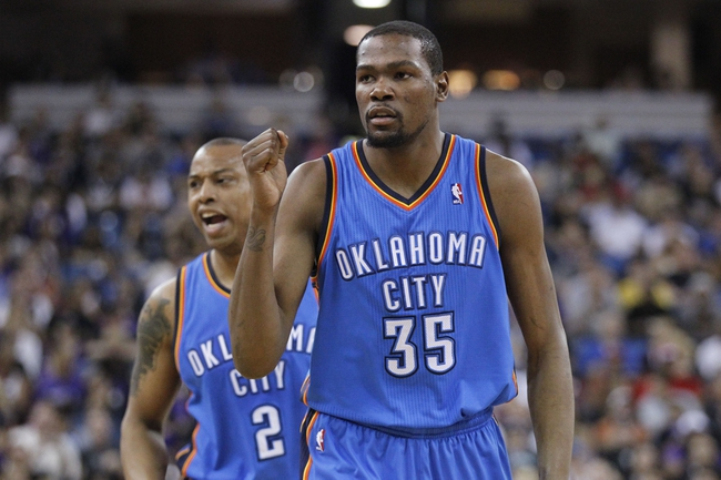 Apr 8, 2014; Sacramento, CA, USA; Oklahoma City Thunder forward Kevin Durant (35) reacts after the Thunder scored a basket against the Sacramento Kings in the second quarter at Sleep Train Arena. Mandatory Credit: Cary Edmondson-USA TODAY Sports