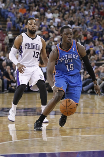 Apr 8, 2014; Sacramento, CA, USA; Oklahoma City Thunder guard Reggie Jackson (15) dribbles the ball against the Sacramento Kings in the second quarter at Sleep Train Arena. Mandatory Credit: Cary Edmondson-USA TODAY Sports