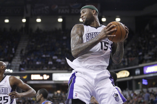 Apr 8, 2014; Sacramento, CA, USA; Sacramento Kings center DeMarcus Cousins (15) holds onto a rebound against the Oklahoma City Thunder in the second quarter at Sleep Train Arena. Mandatory Credit: Cary Edmondson-USA TODAY Sports