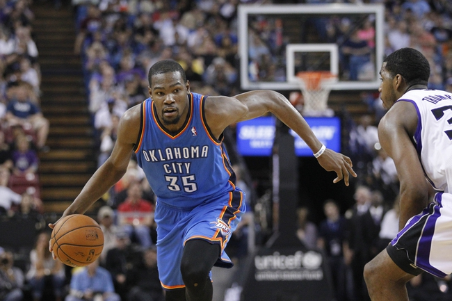 Apr 8, 2014; Sacramento, CA, USA; Oklahoma City Thunder forward Kevin Durant (35) drives to the hoop against the Sacramento Kings in the second quarter at Sleep Train Arena. Mandatory Credit: Cary Edmondson-USA TODAY Sports