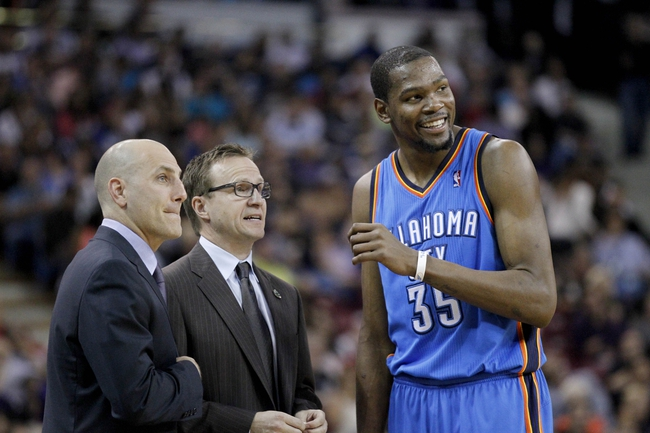 Apr 8, 2014; Sacramento, CA, USA; Oklahoma City Thunder forward Kevin Durant (35) talks with head coach Scott Brooks during a break in the action against the Sacramento Kings in the second quarter at Sleep Train Arena. Mandatory Credit: Cary Edmondson-USA TODAY Sports