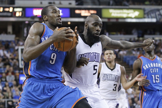 Apr 8, 2014; Sacramento, CA, USA; Oklahoma City Thunder forward Serge Ibaka (9) drives past Sacramento Kings forward Quincy Acy (5) in the second quarter at Sleep Train Arena. Mandatory Credit: Cary Edmondson-USA TODAY Sports
